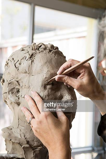 Woman working on Clay Bust