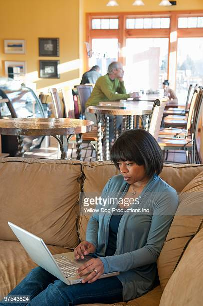woman working on computer in coffee shop