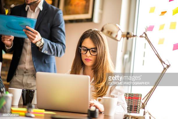 Woman working on computer in the office