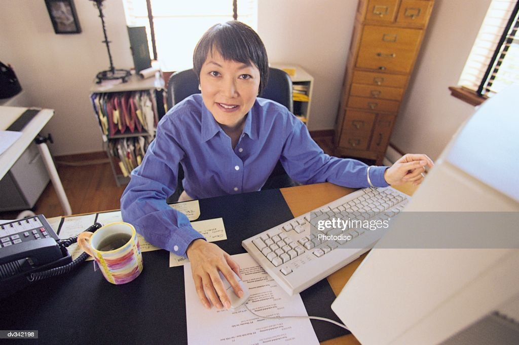 Woman working on computer : Stock Photo