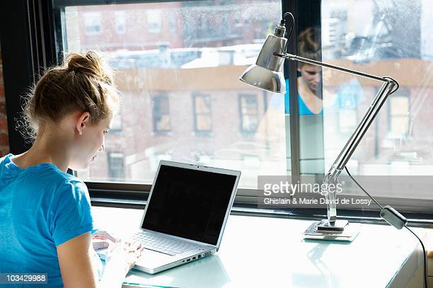 Woman working on her computer