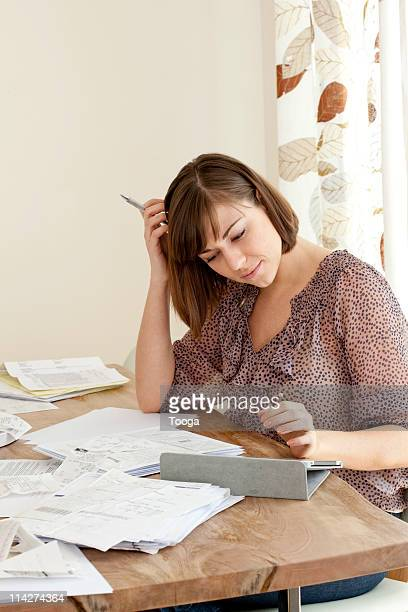 Woman working on taxes and bills