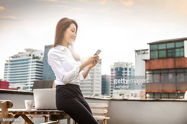 Woman working on the rooftop in Soul