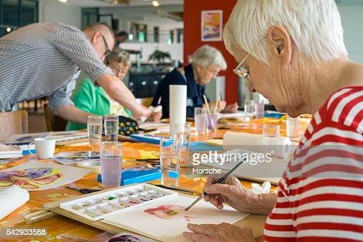 Woman working on watercolor painting. : Foto de stock
