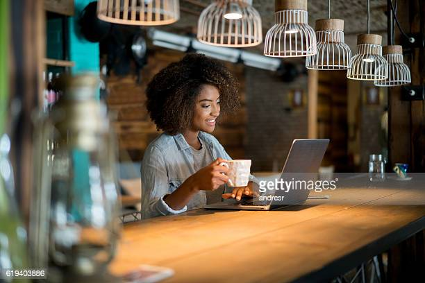 Woman working online at a cafe