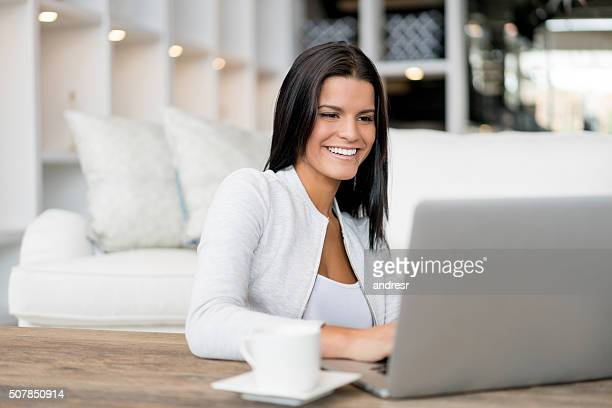 Woman working oon a laptop at home