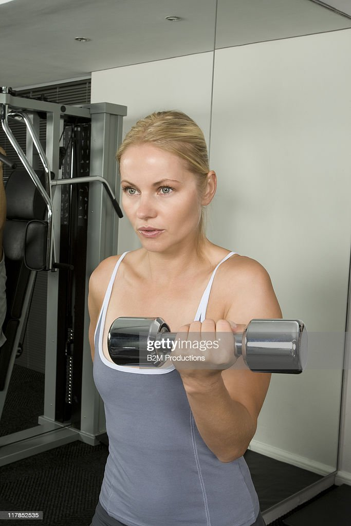 Woman working out in a gym : Stock Photo