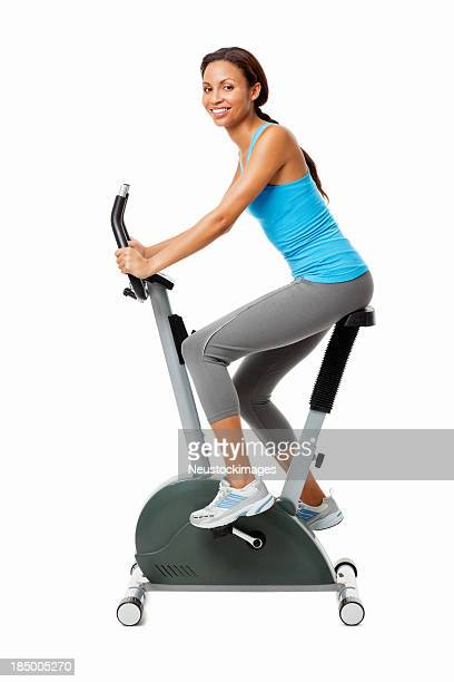 Woman Working Out on Exercise Bike - Isolated