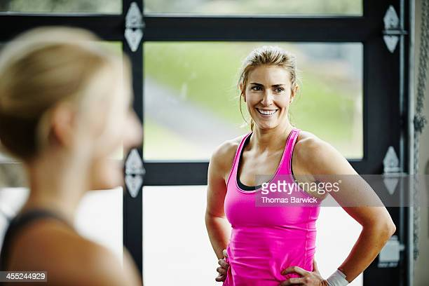 Woman working out with friends in gym gym