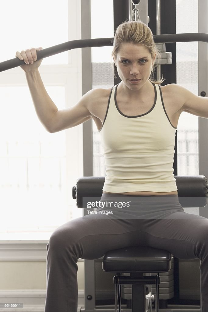 Woman working out with weights : Stock Photo