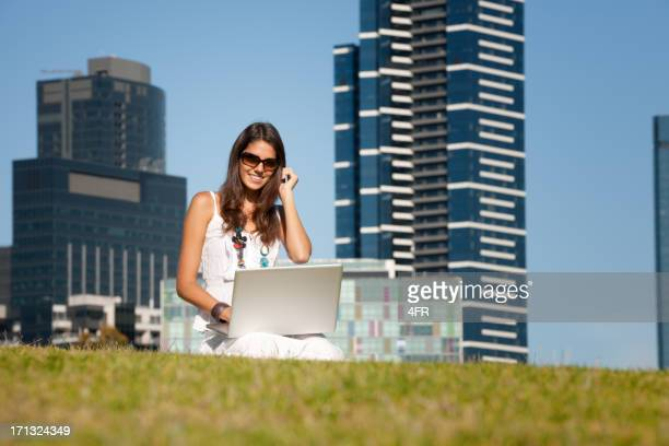 Woman Working Outdoors on her Laptop