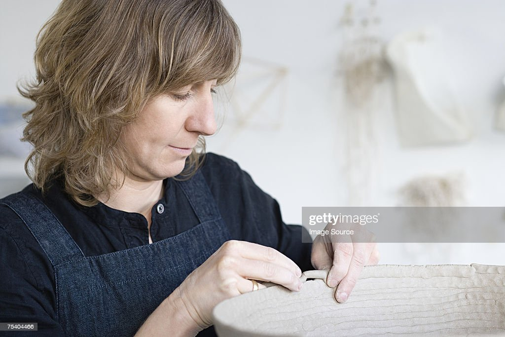 Woman working with clay : Stock Photo