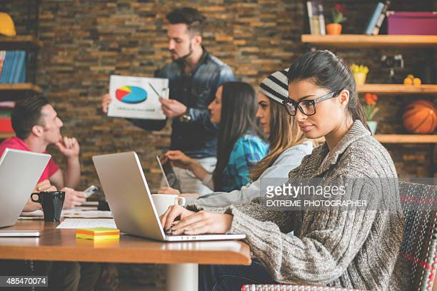 Woman working with coworkers in the office