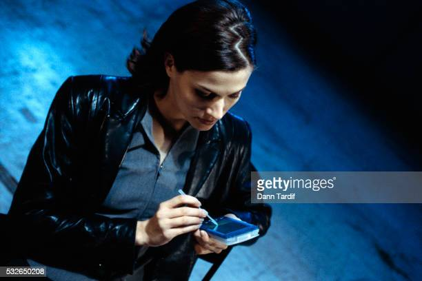 Woman Working with Hand Held Computer