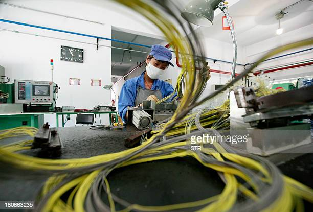 A woman works in a civil explosives factory in Huaibei east China's Anhui province on September 17 2013 Foreign direct investment into China rose 637...