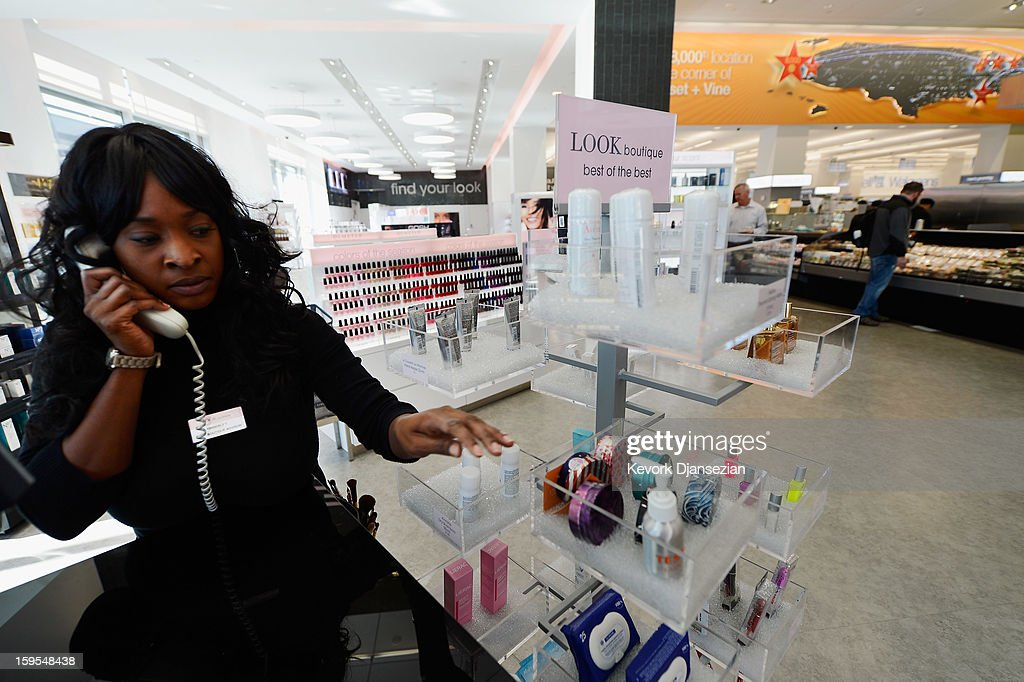 A woman works in a new Walgreens at the corner of Sunset and Vine on January 15, 2013 in Hollywood, California. The new 23,500-square-foot, drugstore, the company's 8,000th store and first West Coast flagship, includes high-end cosmetic, skinand hair care brands, a frozen yogurt station, a fresh sushi bar, a coffee and espresso bar, a juice and smoothie bar, a wine and spirits shop with a and a virtual bartender kiosk and a cigar humidor.