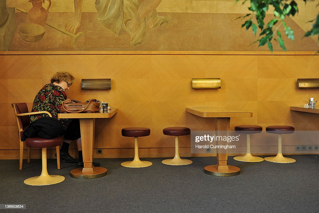 A woman works in the Delegate room, restored in 2004, in Geneva's Palais des Nations on January 12, 2012 in Geneva, Switzerland. The European Headquarters of the United Nations, with its oldest sections built between 1929 and 1938 and originally known as the League of Nations, is studying the work requested for the complex restoration to upgrade its infrastructure and lower its carbon footprint while maintaining its historical and cultural value. The work, which would not begin for several years, could cost more than USD 1 billion.