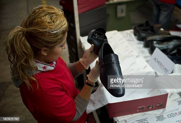 A woman works in the factory where the shoes given to Pope Benedicto XVI during his 2012 visit to Mexcio were made in Leon Guanajuato State on March...
