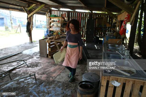 LIONNET A woman works in the ZAD of 'Les Bouillons' on August 6 2015 in MontSaintAignan north of Rouen northern France Alternative environmental...