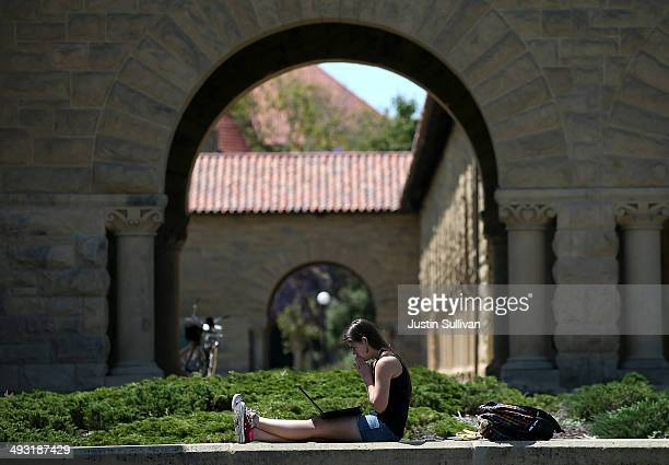 A woman works on a laptop on the Stanford University campus on May 22 2014 in Stanford California According to the Academic Ranking of World...