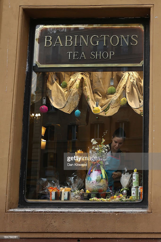 A woman works on an Easter display in the window of 'Babington's Tea Rooms' next to the Spanish Steps on March 27, 2013 in Rome, Italy.