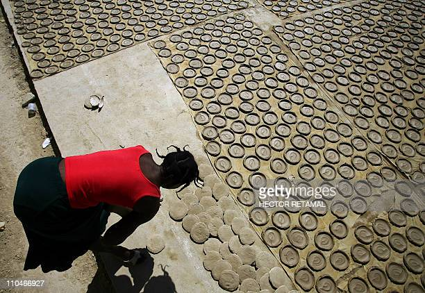 GUIHAIREA woman works on mud cakes in Fort Dimanche in PortauPrince Haiti January 22 2011 A prisoner's worst fate was to be dragged off to Fort...