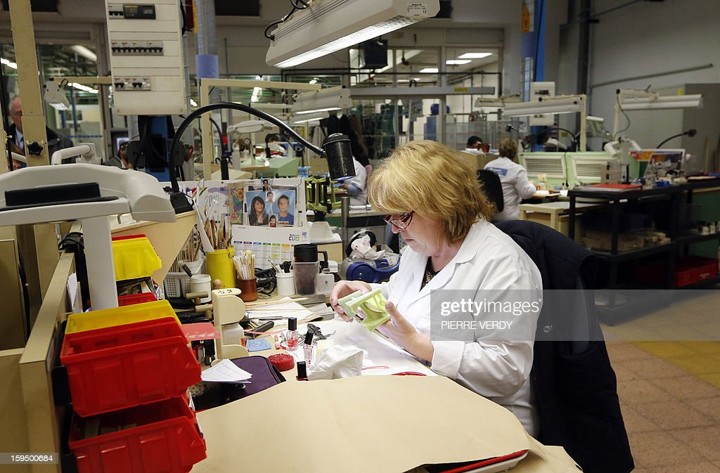A woman works on plastic models, on January 14, 2012 at the Safran - Snecma plant in Gennevilliers, near Paris.