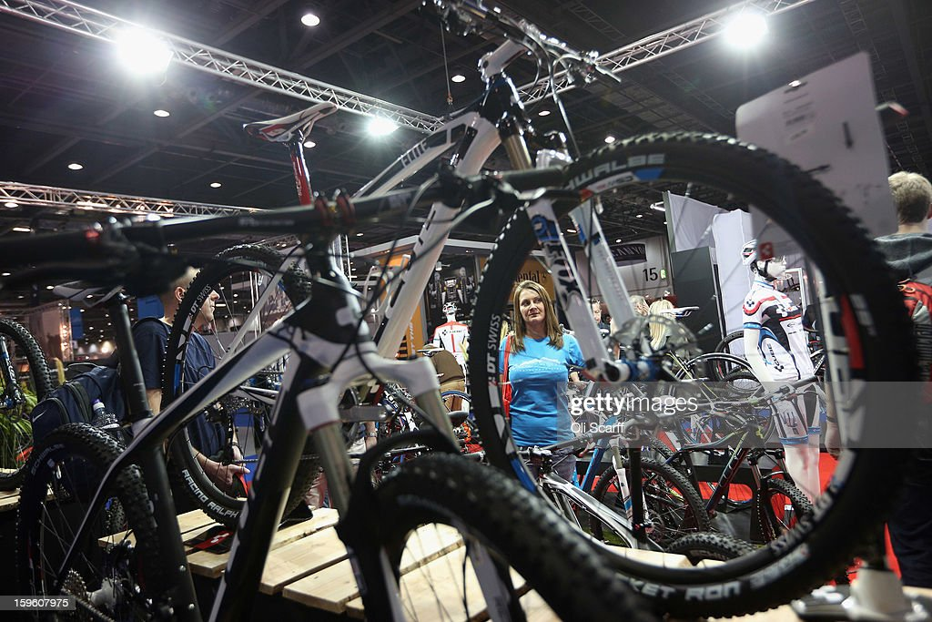 A woman works on the Cube bike stand at the London Bike Show which is being held in the ExCeL Centre on January 17, 2013 in London, England. The ExCeL centre is hosting The Outdoors Show, the London Bike Show and the Active Travel Show which run until January 20, 2013 and features manufacturer trade stalls, speeches, demonstrations and areas where visitors can climb or ride bikes.
