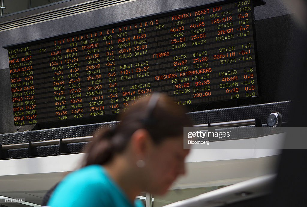 A woman works on the floor of Bolsa Mexicana de Valores (BMV), Mexico's stock exchange, in Mexico City, Mexico, on Wednesday, July 31, 2013. Mexico's economy is forecast to grow 2.8 percent this year based on analyst estimates compiled by Bloomberg. Photographer: Susana Gonzalez/Bloomberg via Getty Images