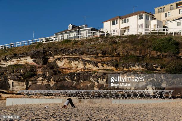A woman works out in front of a work an installation as part of Sculpture By The Sea at Tammaramma beach on October 19 2017 in Sydney Australia