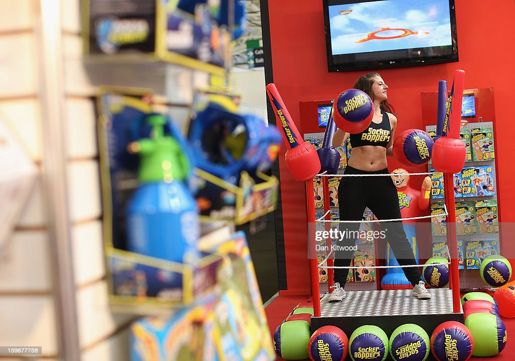 A woman works out on a trade stand during the 2013 London Toy Fair at Olympia Exhibition Centre on January 22, 2013 in London, England. The annual fair which is organised by the British Toy and Hobby Association, brings together toy manufacturers and retailers from around the world.