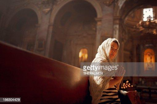 woman worships at a church : Stock Photo