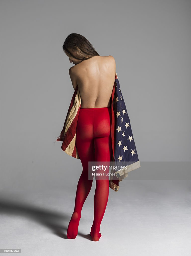 Woman wrapped in american flag showing Patriotism : Stock Photo