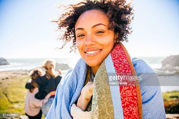 Woman wrapped in blanket on rural hillside