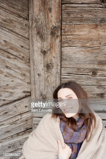 Woman wrapped in blanket : Stock Photo