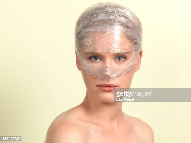 woman wrapped in cling film
