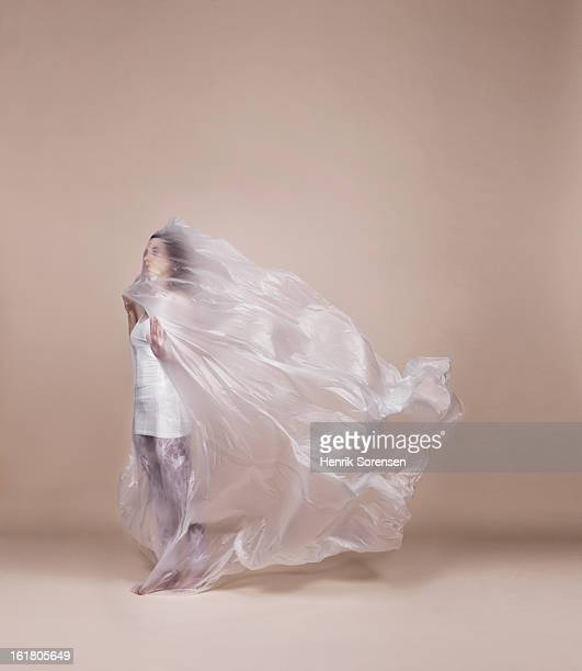 Woman wrapped in plastic