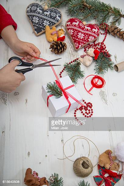 Woman wrapping christmas gifts overhead view