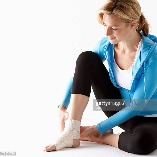 Woman Wrapping Her Ankle