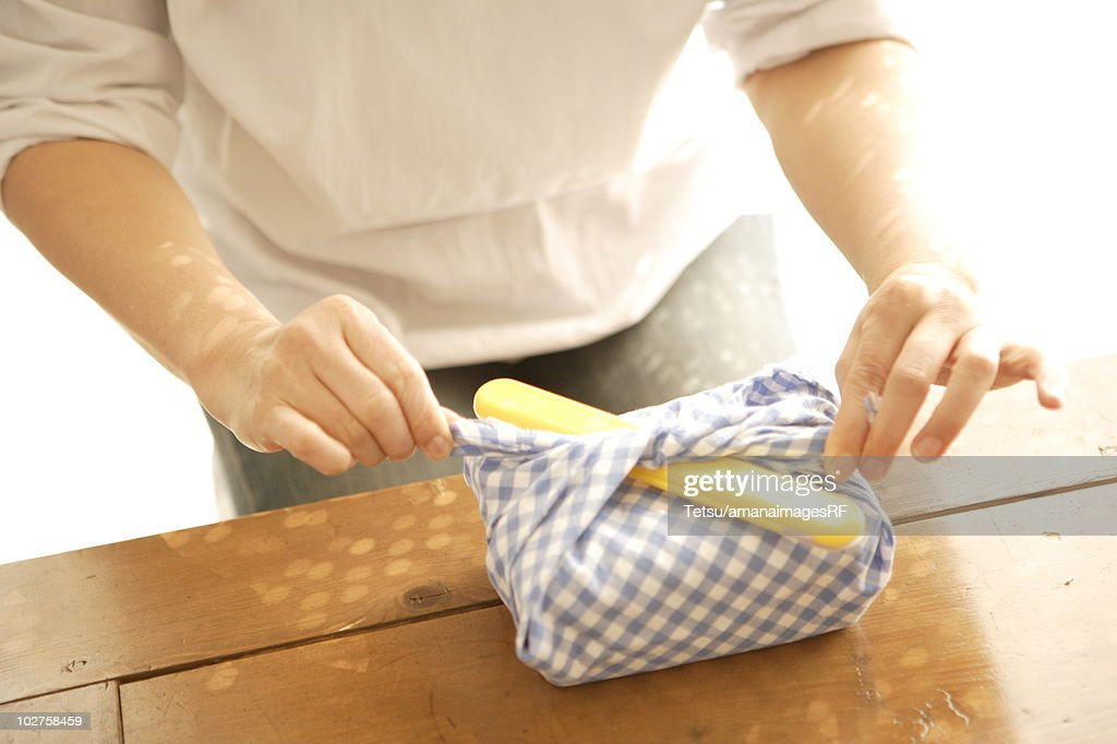 Woman wrapping lunchbox
