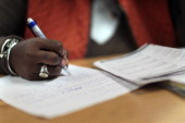 A woman writes a handwritten cover letter at a career training center operated by the New York Department of Labor in Harlem on December 3 2010 in...