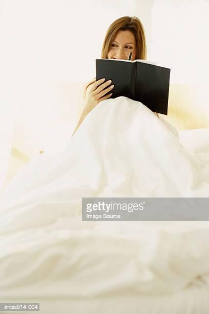 Woman writing a diary