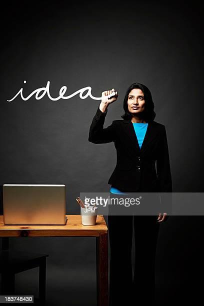 Woman writing down idea
