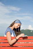 Woman writing on postcard