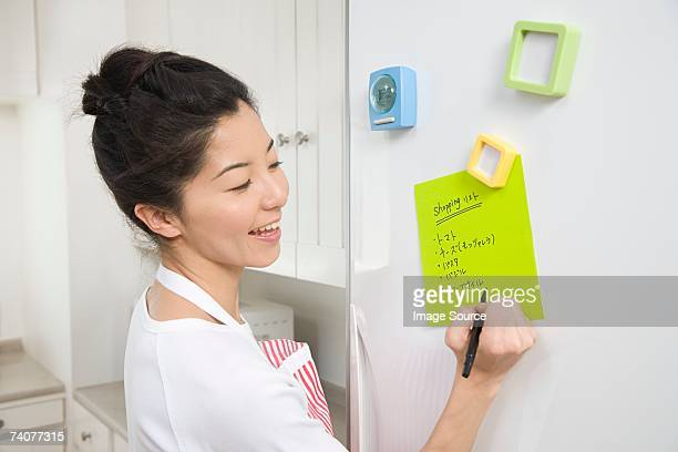 Woman writing shopping list