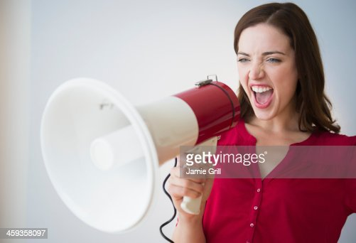 Woman yelling through megaphone