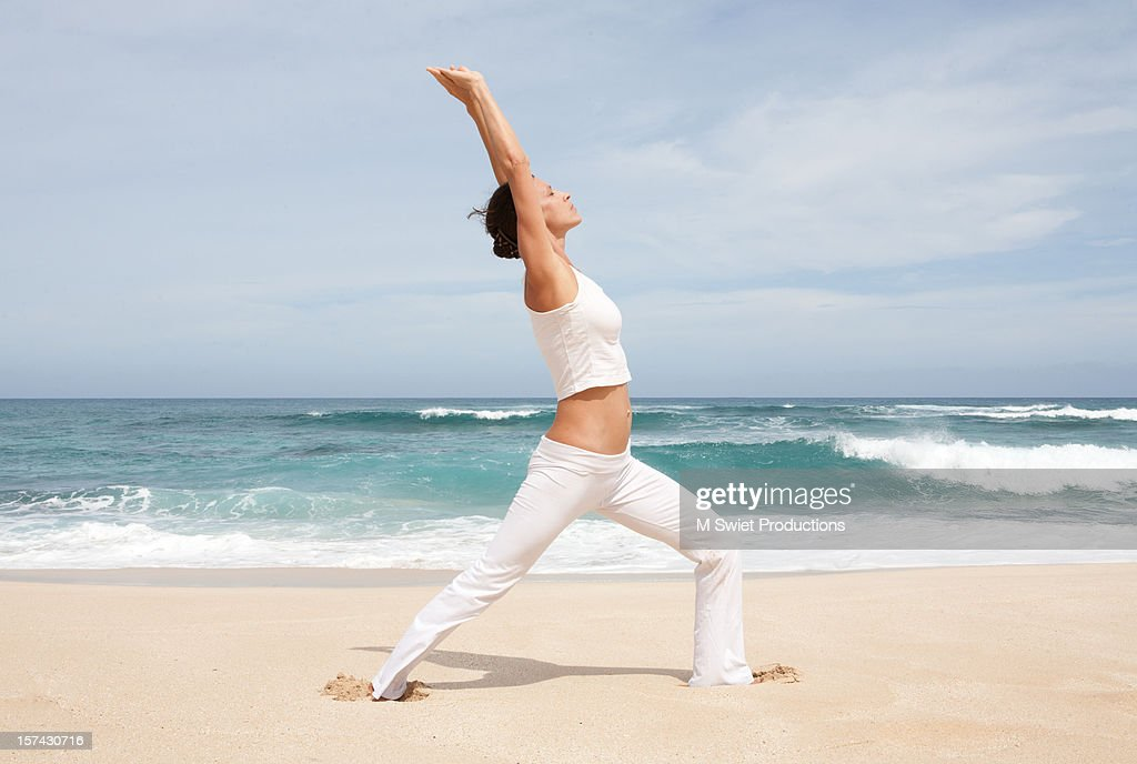Woman yoga beach : Stock Photo