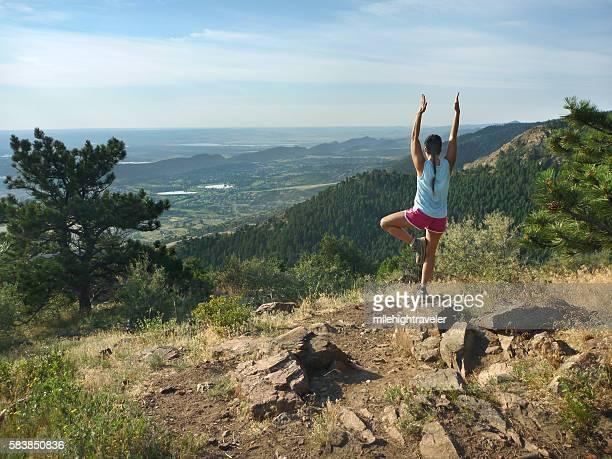 Woman yoga stretch Mount Falcon Morrison Colorado Rocky Mountains