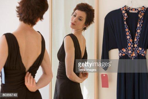 Woman zipping back of dress