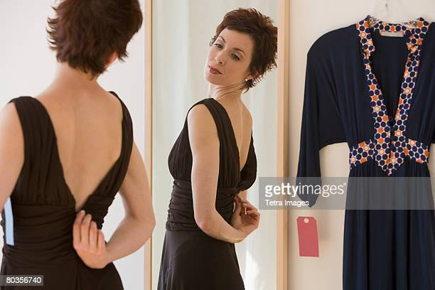 Woman zipping back of dress